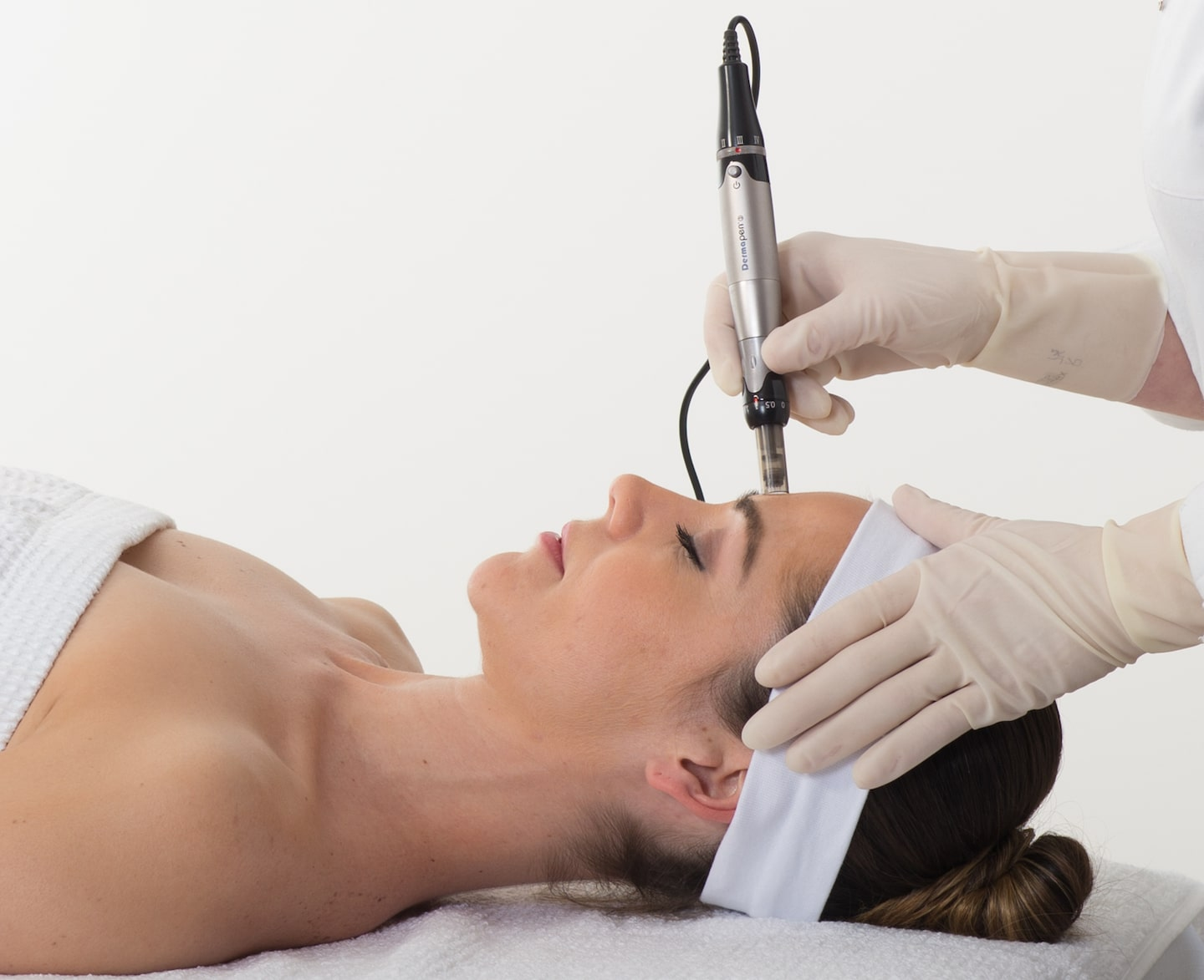 An image of a client having our microneedling treatment in Stirling