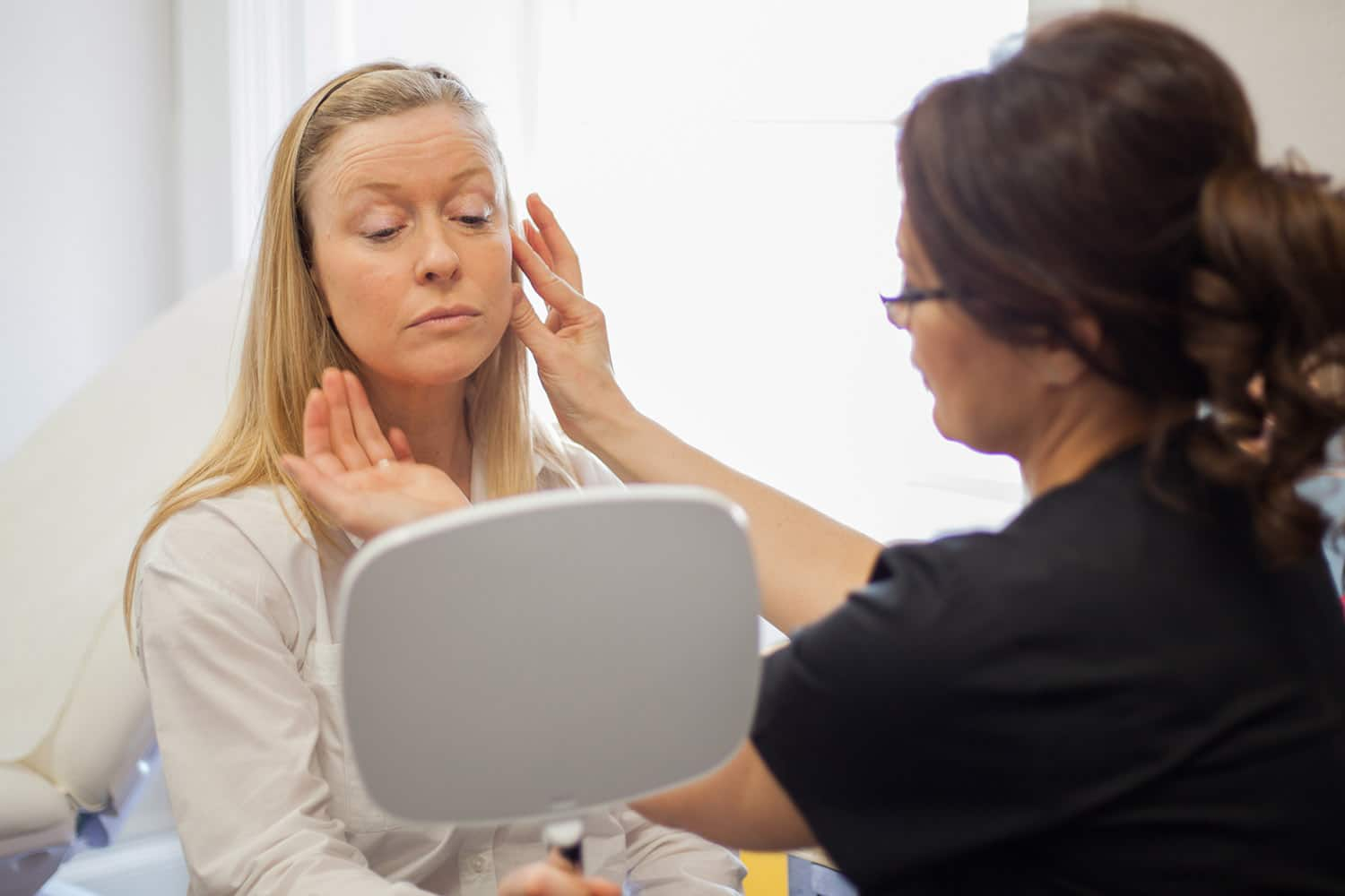 An image of a lady having a facial contouring consultation at our Stirling clinic